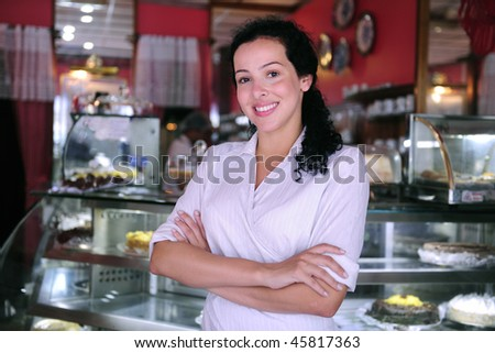 proud and confident owner of a small pastry store - stock photo