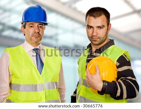 proud boss and worker standing looking at the camera