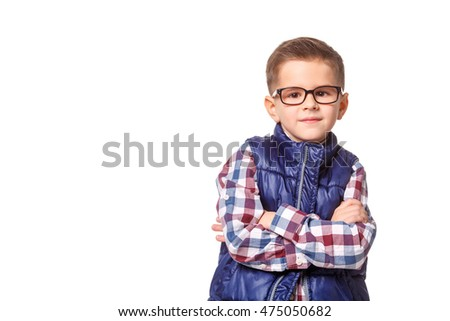 Proud boy in autumn clothes posing on white background