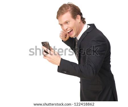 Proud business man excited while looking at his phone. He has a pumping fist gesture. Isolated on white background - stock photo