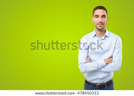 Proud businessman on green background