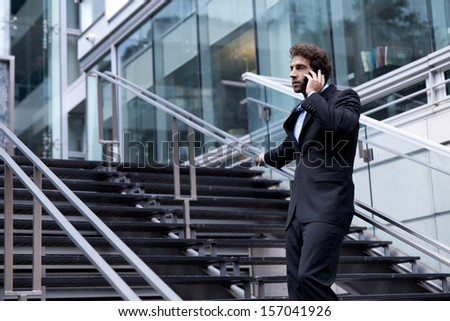 Proud Businessman On the Phone Outside his Office - stock photo