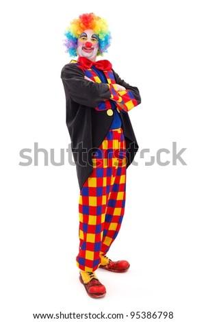 Proud clown in colorful wearing, standing with folded arms on white background - stock photo