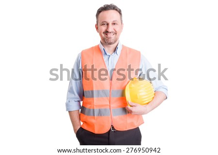 Proud, confident and successful contractor, foreman or builder wearing vest and yellow helmet - stock photo
