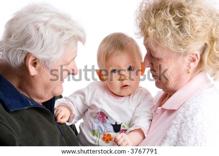 proud grandparents are carrying their cute granddaughter - stock photo
