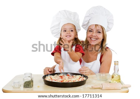 Proud little girl making her first pizza with her mother - isolated - stock photo