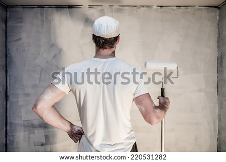 Proud Men Looking at the Painted Wall - Primer is Done - stock photo