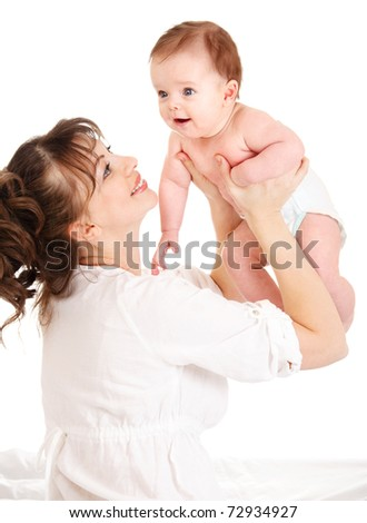 Proud mother raising her baby up high - stock photo