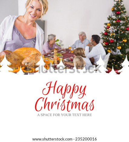 Proud mother showing roast turkey against happy christmas - stock photo