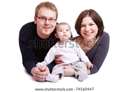 Proud parent smiling with baby girl in their arms - stock photo