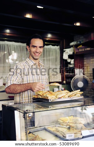 proud small business owner of a snack-bar - stock photo