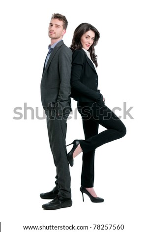 Proud successful business couple looking at camera isolated on white background - stock photo