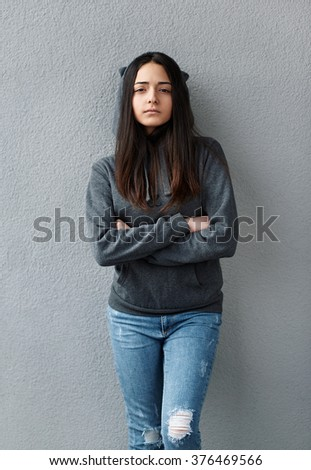 proud teenager girl crossed her arms - stock photo