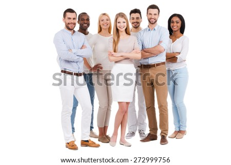 Proud to be a team. Full length of multi-ethnic group of people in smart casual wear looking at camera and smiling while standing against white background - stock photo