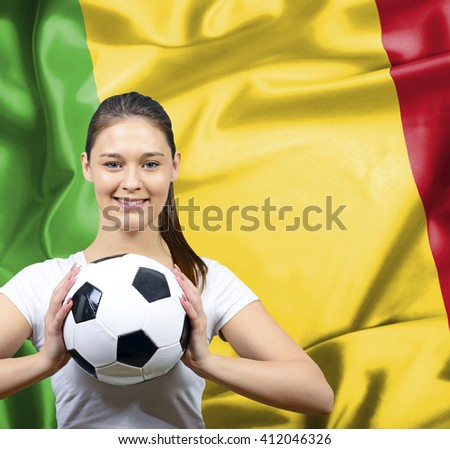 Proud woman football fan of Mali