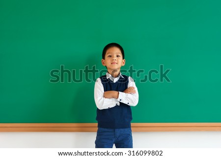 Proud young asian school boy with his arms folded / photo of teen school Chinese boy, creative concept with Back to school theme