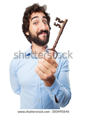 proud young man with vintage key - stock photo