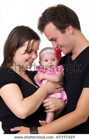Proud young parents holding their infant daughter.