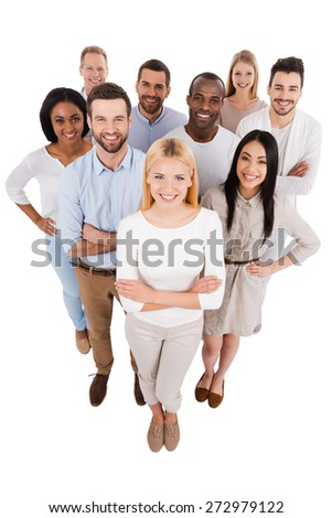 Proudly successful. Top view of positive diverse group of people in smart casual wear looking at camera and smiling while standing close to each other - stock photo