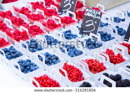 Provence farmers  market with local colorful berries - stock photo