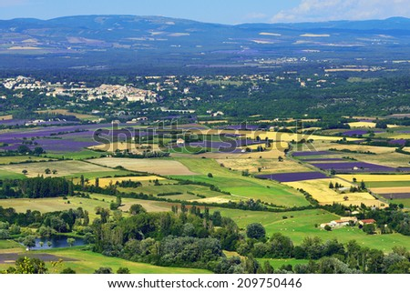 Provence rural landscape. Lavender field and farmhouses near village of Sault - stock photo