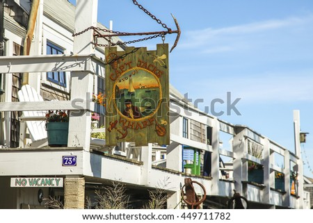 PROVINCETOWN-SEPTEMBER 14: Cap`t Jacks wharf sign in Provincetown, Cape Cod , Massachussets, USA on September  14, 2014.  - stock photo