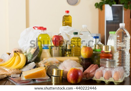 Provision with vegetables and meat for  family at table in interior - stock photo