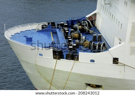 prow front view of a large cruise liner ship, anchor winches on the ship - stock photo