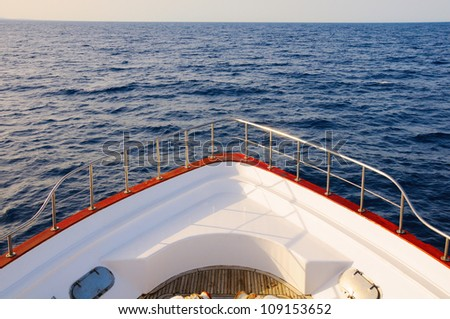 Prow of big wooden yacht in the sea - stock photo