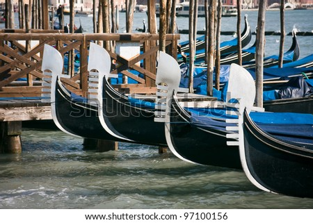 Prows of gondolas moored by Saint Mark's square - Venice, Venezia, Italy, Europe - stock photo