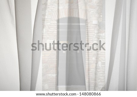 pry out the window curtains what happens - stock photo