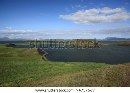 Pseudo craters at Stakholstjorn lagoon in a corner of Myvatn in northern Iceland - stock photo