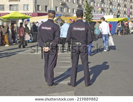 PSKOV, RUSSIA - SEPTEMBER 20, 2014: The policemen are keeping order at the autumn fair
