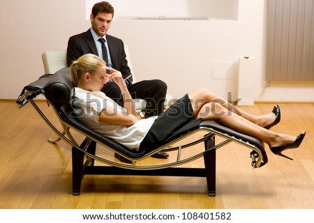 psychiatrist examining a female patient - stock photo