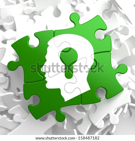 Psychological Concept - Profile of Head with a Keyhole Located on Green Puzzle Pieces. - stock photo
