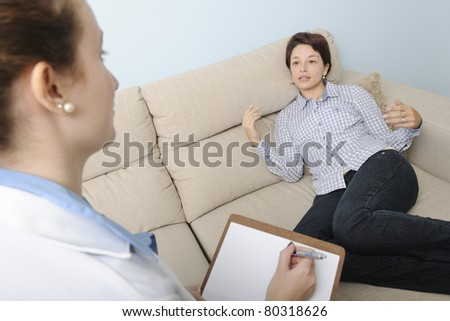 psychologist or psychiatrist listening to patient - stock photo