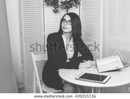 Psychologist sitting on the chair and taking notes in  office. woman psychologist thoughtfully reviewing its records - stock photo