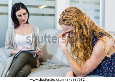 Psychologist talking with her depressed patient in the office