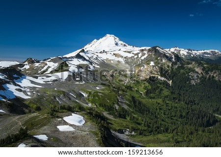 Ptarmigan Ridge on slopes of snowcapped Mount Baker, Washington state Cascades - stock photo
