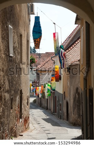 PTUJ - AUGUST 19: medieval street is decorated with colorful paper lanterns for the Days of Poetry and Wine on August 19, 2013 in Ptuj, Slovenia. It is a traditional festival of poetry and wine.