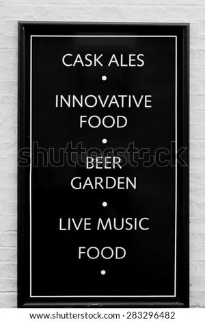 Pub/Restaurant facilities noticeboard monochrome image - stock photo