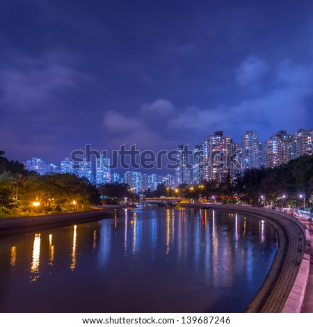 Public apartment near river under twilight blue hour at in Tai Po, Hong Kong