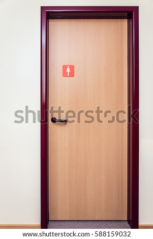 Public Bathroom Door With Sign For Women