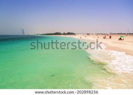 Public beach with turquoise water in Dubai, UAE - stock photo
