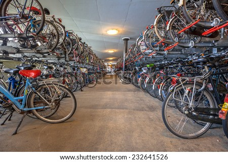 "Public Bicycle parking Groningen central station. The city of Groningen has been voted "" most cycle friendly city of the Netherlands"" for 3 years in a row. - stock photo"