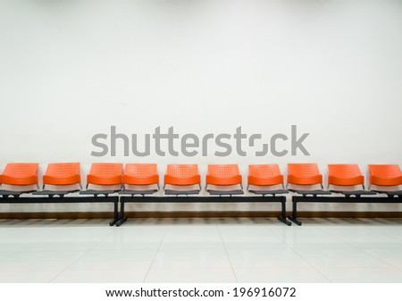 public chair and wall for passengers in station