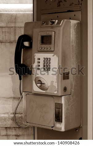public coin-operated telephone,sepia