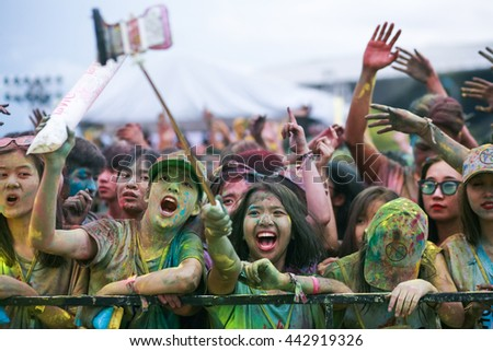 "Public color run event in Danang, Vietnam - June 25, 2016. A Thousand of young people joined the joyful race named ""Color Me Run"". Color Run is held annually in Vietnam."