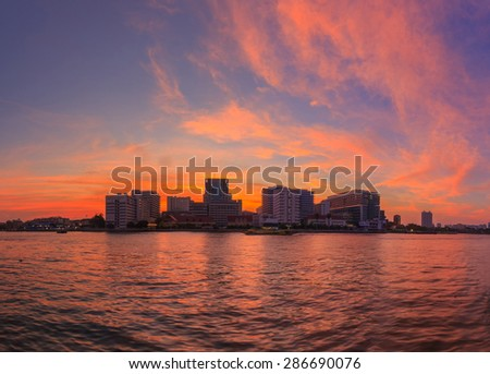 Public Hospital at twilight time in the river, Bangkok, Thailand - stock photo