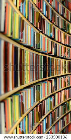 Public library bookshelf - stock photo